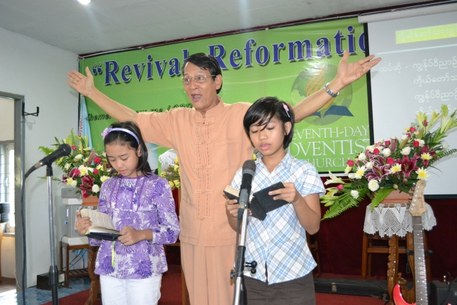 Young girls helping out during song service time