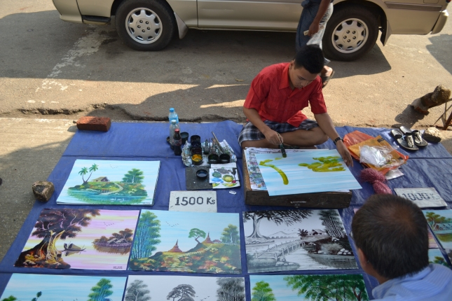 Young artist on the streets of Burma, does each painting in less than 3 minutes