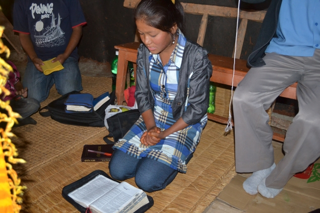 Maya Helping To Read The Bible In Church