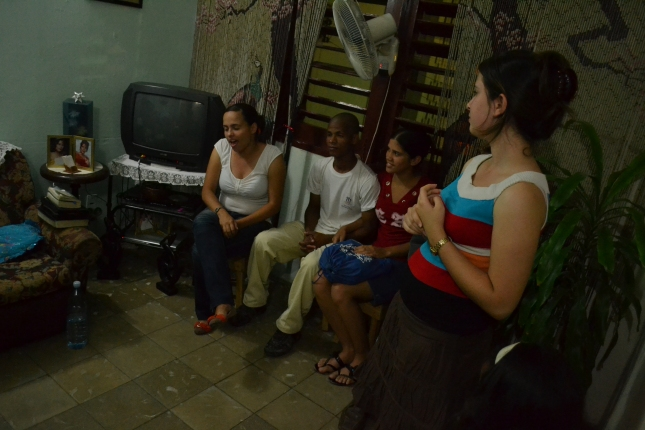 Young Girl Leading A House Meeting In Cuba