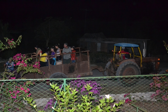 People Coming To The Nightly Meeting By Tractor